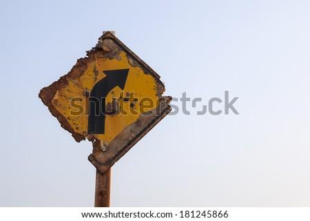 Decay traffic sign beside the beach because of salt vapor. - stock photo