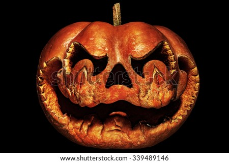 Decaying, scary Halloween pumpkin resembling a Chinese dragon head, isolated on black - stock photo
