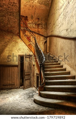 Decaying staircase in an abandoned central office - stock photo