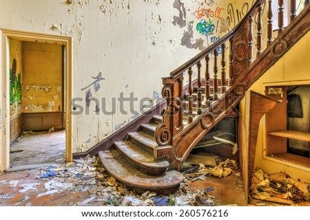 Decaying staircase in an abandoned manor, HDR - stock photo