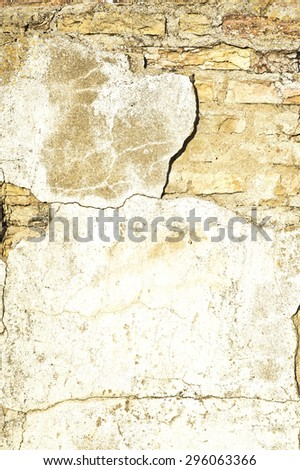 Decaying weathered cement brick wall with blank space for text - stock photo