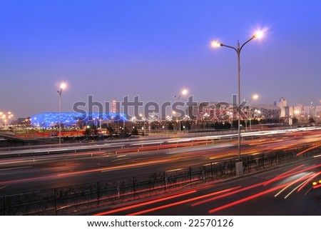 """December 22: Beijing's Olympic Sports Center Gymnasium (""""water-cube"""" and """"bird-nest"""") illuminated at dusk on December 22th, 2008 after the 2008 Olympic Games (August, 2008). - stock photo"""