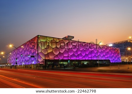 """December 18: Beijing's swimming Olympic Stadium (""""watercube"""") illuminated at dusk on December 18th, 2008 after the 2008 Olympic Games (August, 2008) - stock photo"""