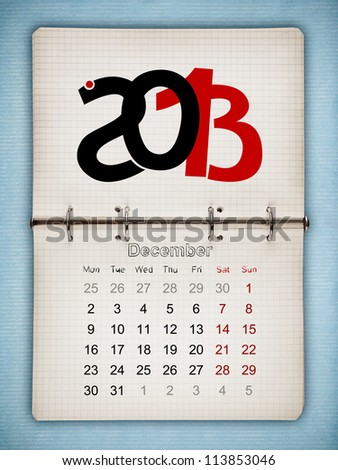 December 2013 Calendar, open old notepad on blue paper - stock photo