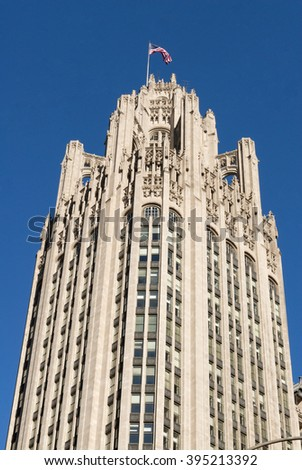 December 6 2013. Chicago's old Tribune Tower with flag waving in the breeze. Editorial - stock photo