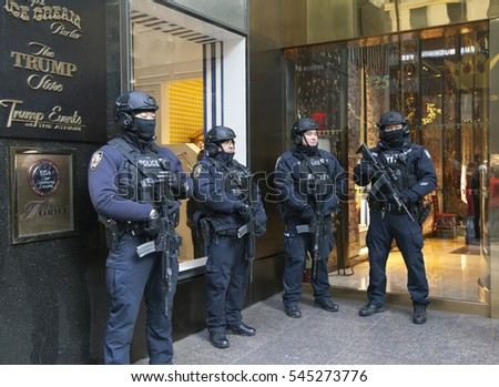 DECEMBER 19 - NEW YORK, NEW YORK: Police officers stand guard in front of Trump Tower on 56th street and 5th avenue. Taken December 19, 2016 in NYC.