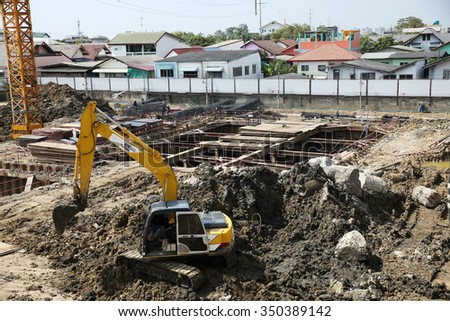 DECEMBER 12, 2015 ; NONTHABURI - THAILAND : Concrete pile foundation under-construction with heavy equipment at Electricity generating authority of Thailand, Nonthaburi province.