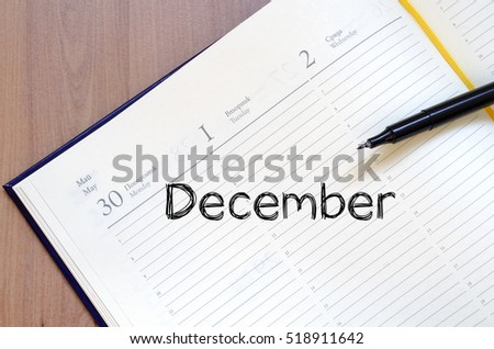 December text concept write on notebook