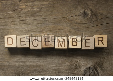 December text on a wooden background - stock photo