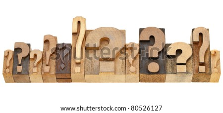 decision making concept - a row of question marks - vintage wood letterpress printing blocks - stock photo