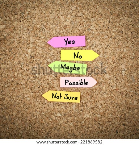 Decision / Yes, No, Maybe , Possible and Not Sure Options on Cork Board - stock photo