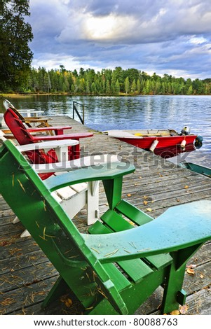 Deck chairs at dock on Lake of Two Rivers in Algonquin Park, Ontario, Canada - stock photo