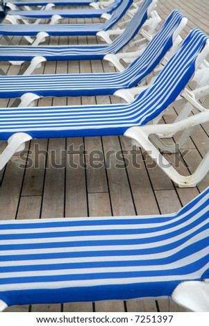 Deck chairs on a cruise ship by the pool
