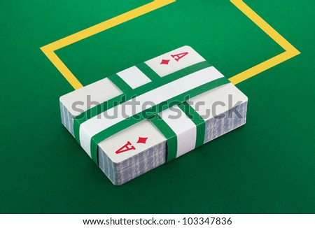 Deck of cards on poker table