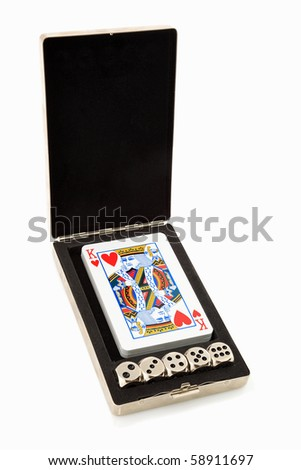 Deck of cards with the King of Hearts and dice. - stock photo