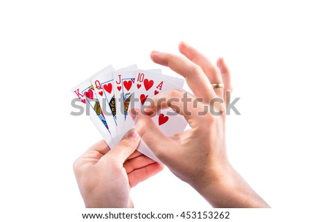 Deck of poker hands surrounding the heart in isolated background - stock photo