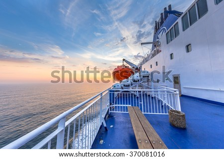 Deck on Ferry sailing across the Northsea during beautiful sunset - stock photo