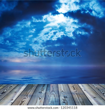 Deck view of a ocean or lake during twilight
