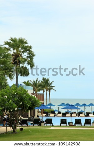 Deckchairs and swimming pool near the sea