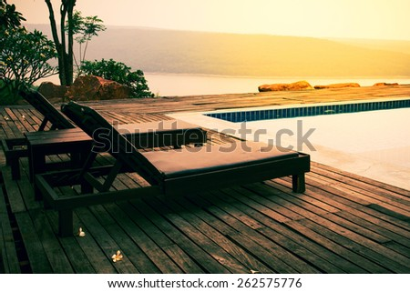 Deckchairs for swimming pool in summer  - stock photo