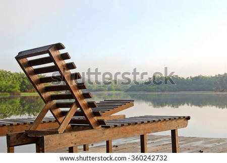 Deckchairs on a lookout point in the Amazon rainforest near Manaus, Brazil - stock photo