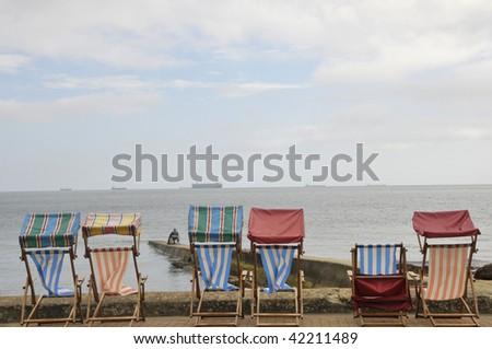 Deckchairs on seafront, Sandown, Isle of Wight - stock photo