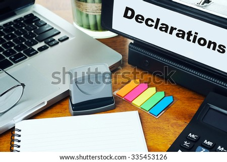Declarations - Ring Binder on Office Desktop with Office Supplies. Business Concept on Toned and Blurred Background - stock photo
