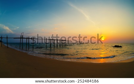 Decline on the seashore, the destroyed pier - stock photo