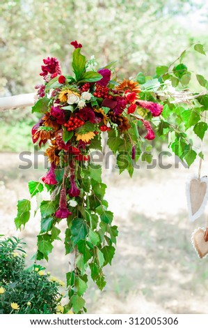 Decor element flowers on a wedding arch in the wood - stock photo