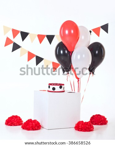 Decor for baby's or child's Birthday party. Cake smash. Red, black and white colors - stock photo