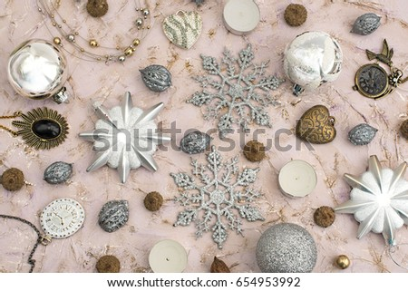 Decor for new year decorations on the Christmas tree. Balls, nuts, candles, snowflakes, glitter, watch
