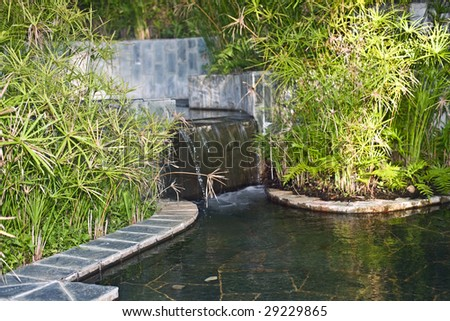 Decor waterfall in swimming pool.  Landscape. - stock photo
