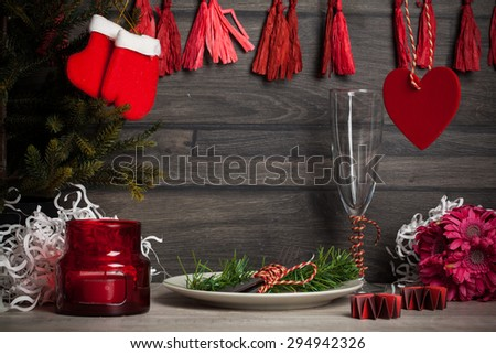 Decorate christmas plate and pines on wooden surface - stock photo