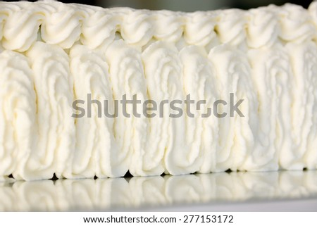 decorate cream cake from a pastry bag - stock photo