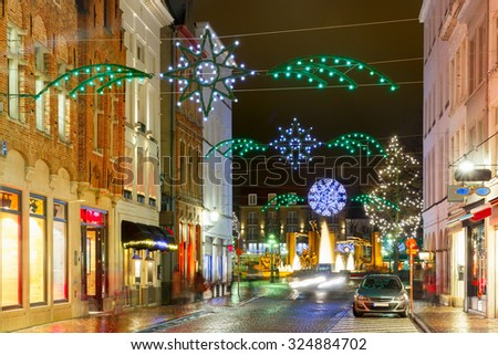 Decorated and illuminated Christmas street in Bruges, Belgium - stock photo