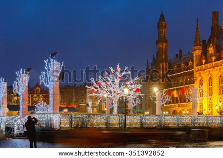 Decorated and illuminated Christmas tree on the rink in front of Province Court at Market Place in the center of Bruges, Belgium - stock photo