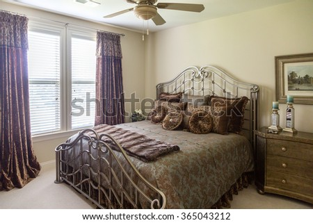 Decorated bedroom with fancy bed coverings - stock photo