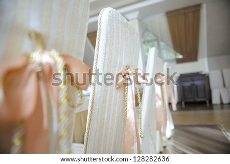 decorated chairs with beige ribbons