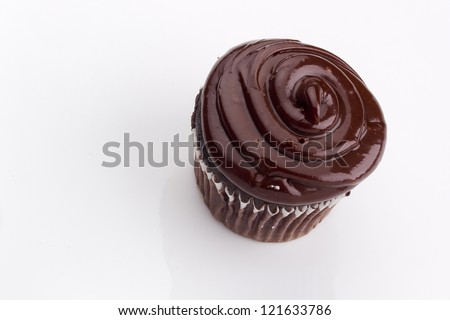 Decorated chocolate cupcake on a white background. - stock photo