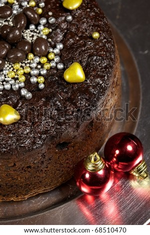 Decorated Christmas cake with baubles