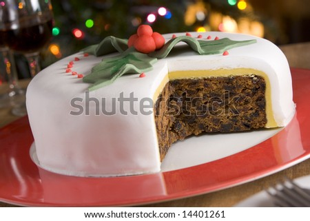 Decorated Christmas Fruit Cake with slices taken - stock photo
