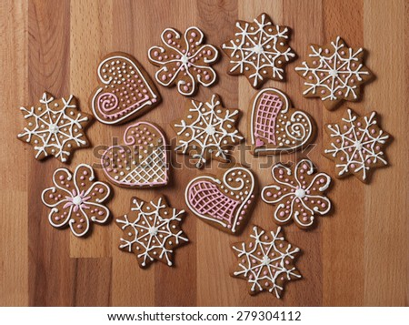 Decorated Christmas gingerbread cookies on wooden background - stock photo