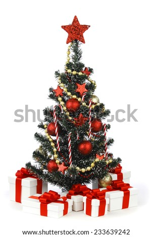Decorated Christmas tree and presents isolated on white background