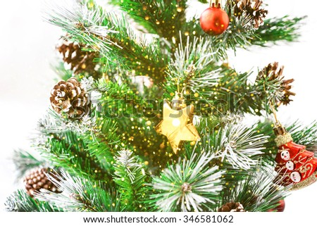 Decorated Christmas tree. Beautiful Christmas living room with Christmas tree and glitter lights - stock photo