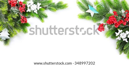 Decorated Christmas tree branch with red berries on white background - stock photo