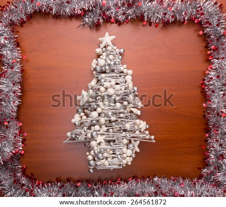Decorated christmas tree framed with streamer - stock photo