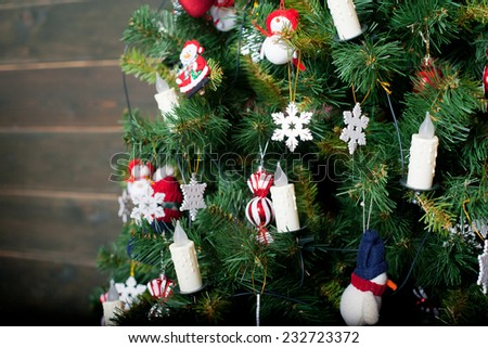 Decorated Christmas tree in red and white colors