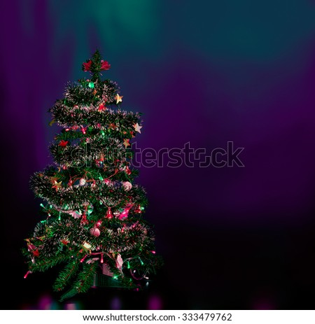 decorated Christmas tree   on blue  background - stock photo