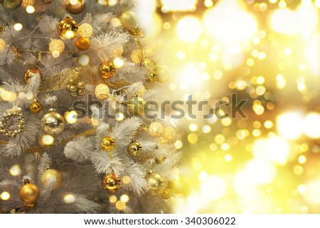 Decorated Christmas tree on blurred - stock photo
