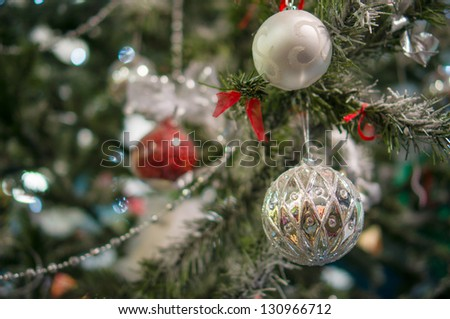 Decorated christmas tree on street with balls, toys, lamps and garlands - stock photo